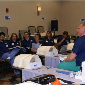 Instructors Dean Parsons and Terri Shade lead a C-Section workshop on Tuesday night utilizing NIFA's new 'C-Section Molded Simulators.